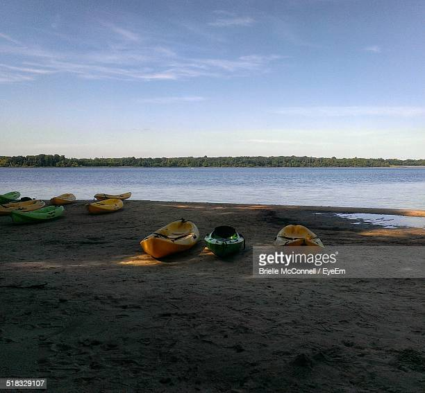 canoes on beach against sky - mcconnell stock pictures, royalty-free photos & images