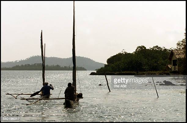 Canoes on the narrow waterway between Buka and Bougainville Islands Papua New Guinea 22 January 2002 THE AGE Picture by ANGELA WYLIE