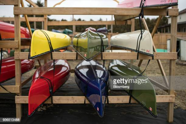 Canoes sit secured to a rack at the Holy Cow Canoe Co production facility in Guelph Ontario Canada on Thursday March 1 2018 Statistics Canada is...