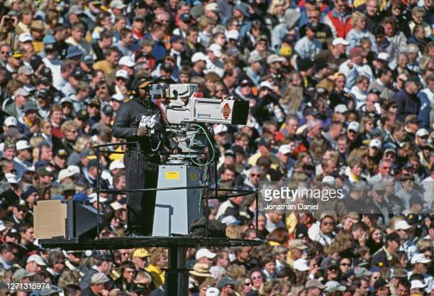Canon Digi Super 70 television camera and operator during the NCAA Big Ten Conference college football game between the University of Michigan...