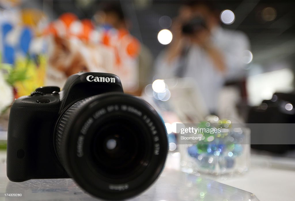A Canon Inc. digital single-lens reflex (DSLR) camera is displayed at an electronics store in Tokyo, Japan, on Tuesday, July 23, 2013. Canon Inc., the world's largest camera maker, is scheduled to release earnings on July 24. Photographer: Tomohiro Ohsumi/Bloomberg via Getty Images