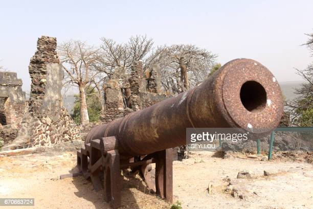 A canon is seen on Kunta Kinteh island formerly known as James Island an island in the Gambia River 30 km from the river mouth and near Juffureh on...