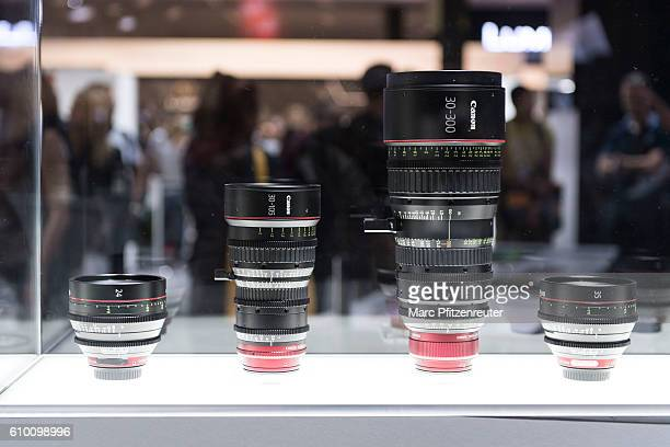 Canon lenses are displayed at the 2016 Photokina trade fair on September 24 2016 in Cologne Germany Photokina is the world's largest trade fair for...