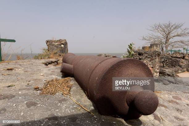 A canon lies on the beach on Kunta Kinteh island formerly known as James Island an island in the Gambia River 30 km from the river mouth and near...