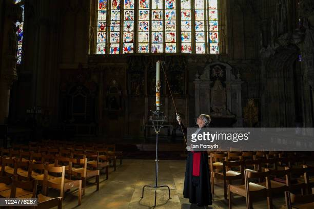 Canon Maggie McLean the Canon Missioner at York Minster lights the Paschal Candle a Christian symbol of Christ rising from the empty tomb on the...