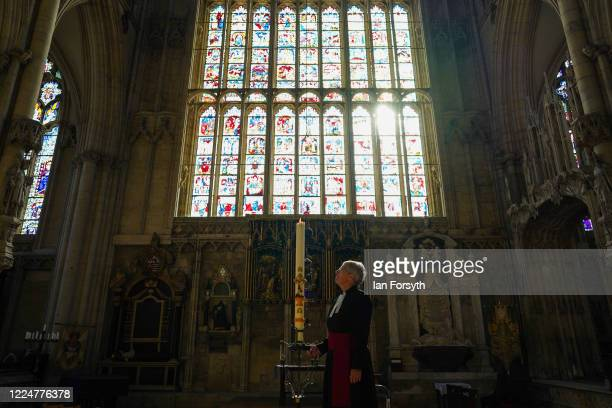 Canon Maggie McLean, the Canon Missioner at York Minster, lights the Paschal Candle, a Christian symbol of Christ rising from the empty tomb on the...