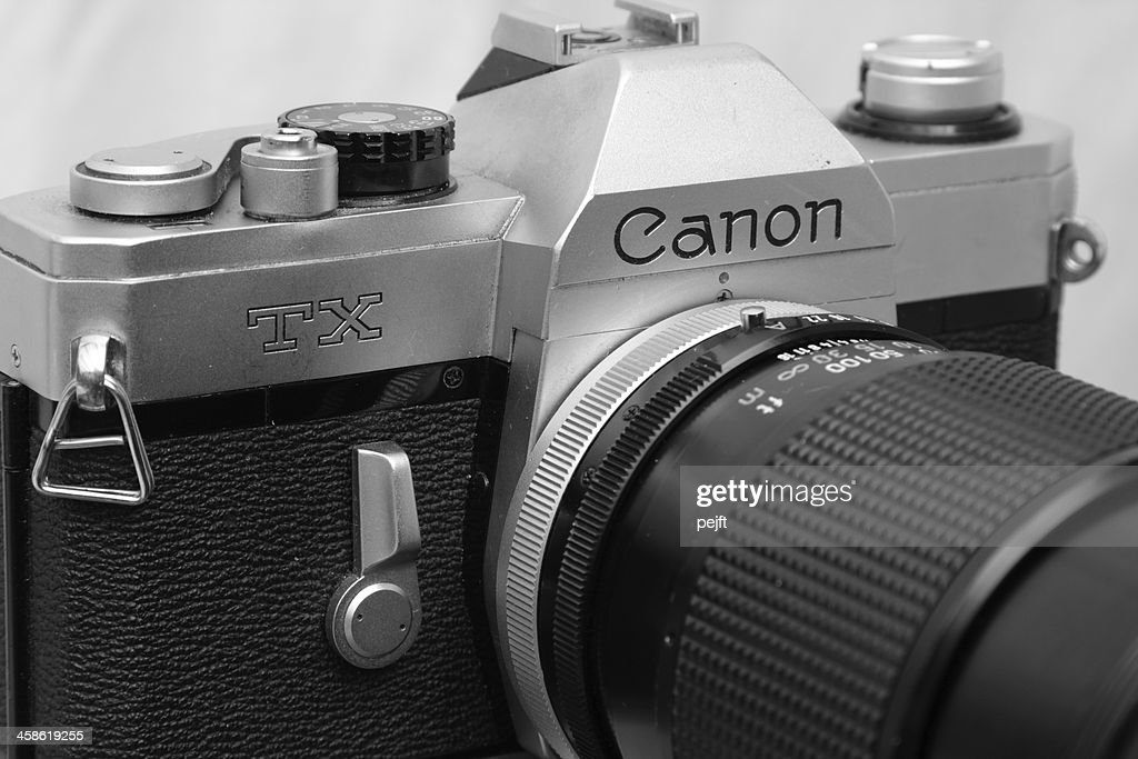 Canon SLR with 135 mm zoom lens : Stock Photo