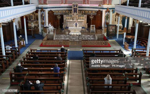 Canon Tom White holds a mass service at St Mary's Catholic Chuch in Calton, Glasgow, after coronavirus regulations that forced the closure of...