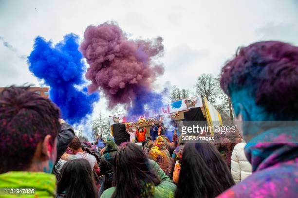 Canons are seen throwing colored powders during the celebration Millions of people around the world celebrate the annual Holi Hangámá Festival also...