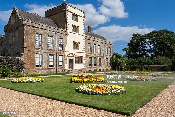 Canons Ashby House stately home, with garden in bloom, Northamptonshire, England.