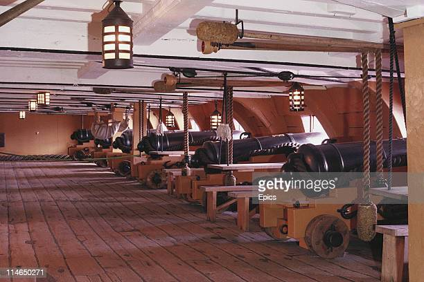 Canons face out from the lower gun deck of the warship HMS Victory which is in dry dock in Portsmouth Hampshire England July 1987 HMS Victory was he...