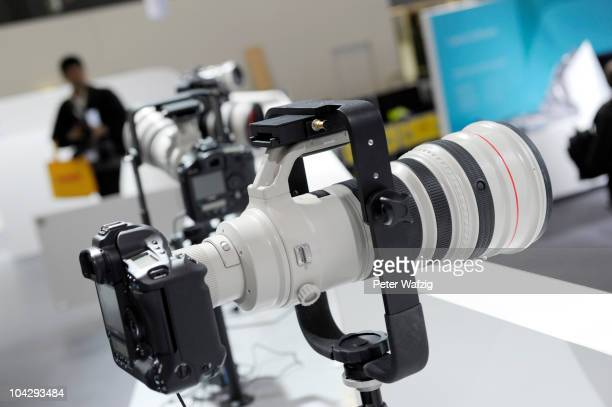 Canons super telephoto lenses in the lineup are dispayed during the press preview of the Photokina 2010 trade fair on September 20 2010 in Cologne...