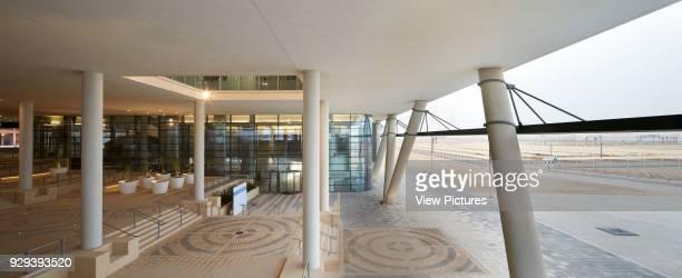 Canopied exterior entrance courtyard. Siemens Masdar, Abu Dhabi, United Arab Emirates. Architect: Sheppard Robson, 2014.