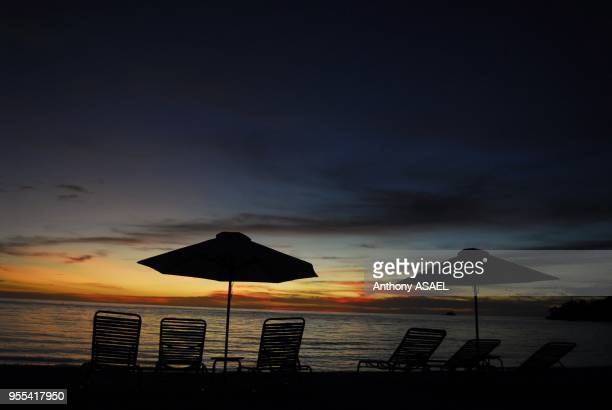 canopies and deck chairs on seashore at dusk Koror Palau