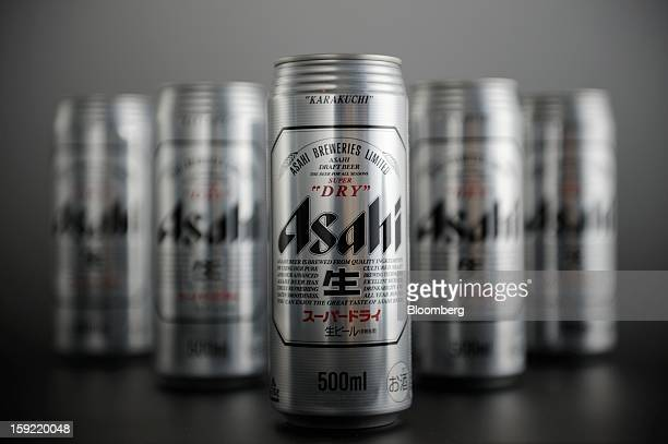 Cans of Asahi Breweries Ltd Asahi Super Dry beer are arranged for a photograph in Kawasaki Kanagawa Prefecture Japan on Wednesday Jan 9 2013 Suntory...