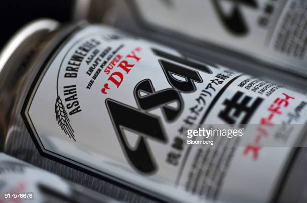 Cans of Asahi Breweries Ltd's Asahi Super Dry beer are arranged for a photograph in Tokyo Japan on Monday Feb 12 2018 Asahi Group Holdings Ltd parent...