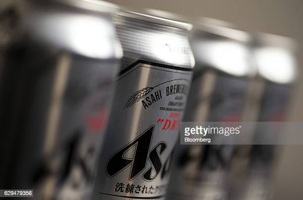 Cans of Asahi Breweries Ltd's Asahi Super Dry beer sit displayed for a photograph in Tokyo Japan on Tuesday Dec 13 2016 Asahi agreed to buy SABMiller...