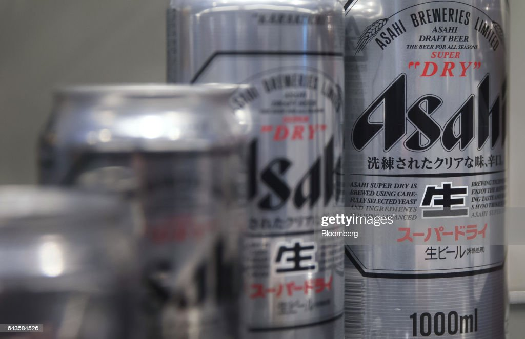 Cans of Asahi Super Dry beer are displayed at the Asahi Kanagawa Brewery, operated by Asahi Breweries Ltd., a unit of Asahi Group Holdings Ltd., in Minamiashigara, Kanagawa, Japan, on Monday, Feb. 20, 2017. Asahi, Japan's largest beermaker, is looking to exit its 19.9 percent stake in Tsingtao Brewery Co. after eight years. Photographer: Tomohiro Ohsumi/Bloomberg via Getty Images