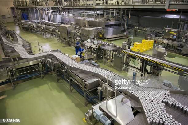 Cans of Asahi Super Dry beer move on the production line of the Asahi Kanagawa Brewery operated by Asahi Breweries Ltd a unit of Asahi Group Holdings...