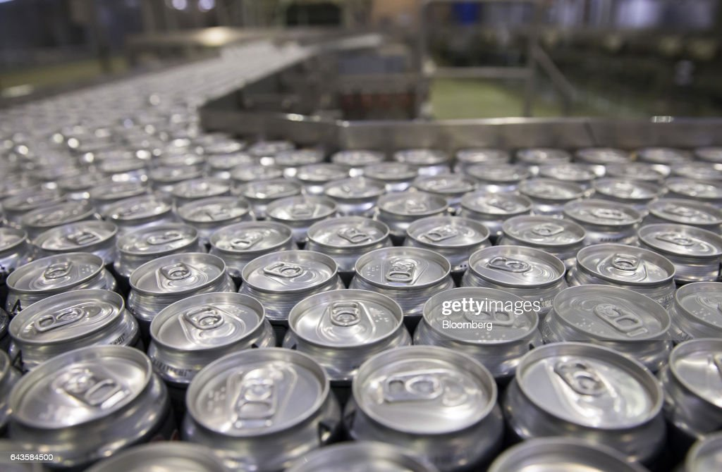 Cans of Asahi Super Dry beer move on the production line of the Asahi Kanagawa Brewery, operated by Asahi Breweries Ltd., a unit of Asahi Group Holdings Ltd., in Minamiashigara, Kanagawa, Japan, on Monday, Feb. 20, 2017. Asahi, Japan's largest beermaker, is looking to exit its 19.9 percent stake in Tsingtao Brewery Co. after eight years. Photographer: Tomohiro Ohsumi/Bloomberg via Getty Images