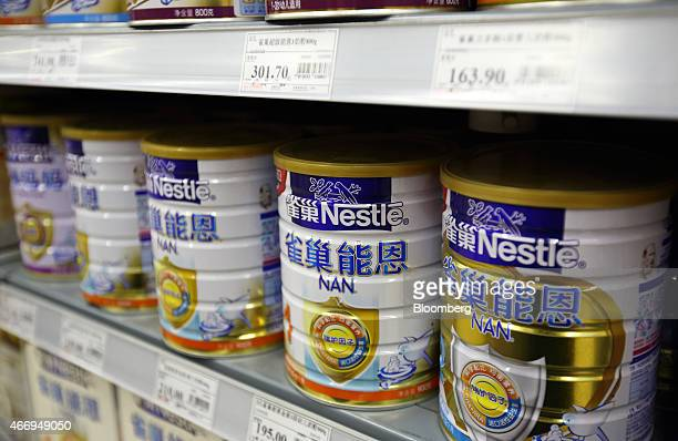 Cans of baby formula manufactured by Nestle SA sit on a shelf inside a supermarket in Beijing China on Saturday March 14 2015 China is the world's...