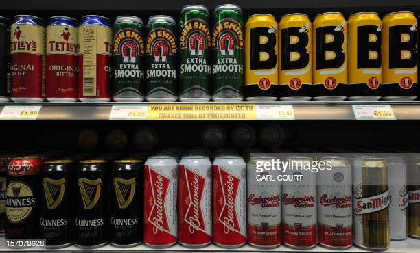 Cans of beer line a shelf in a store in central London on November 28 2012 The British government was to announce plans on November 28 for a minimum...