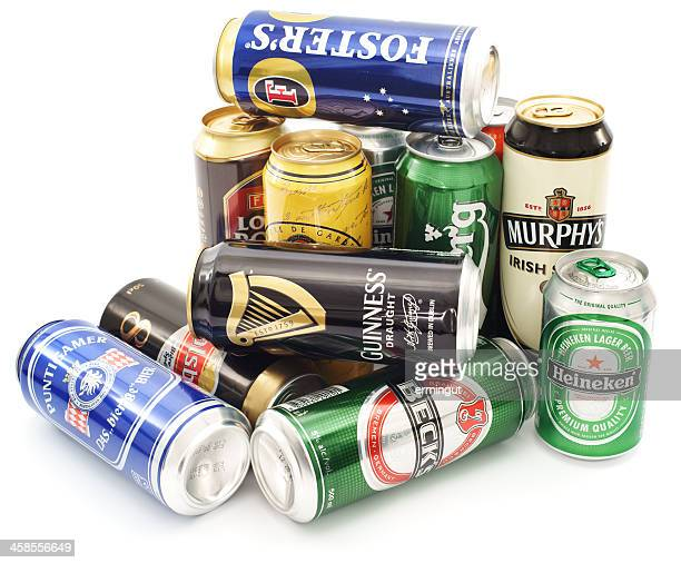 Cans of beer pile isolated on white