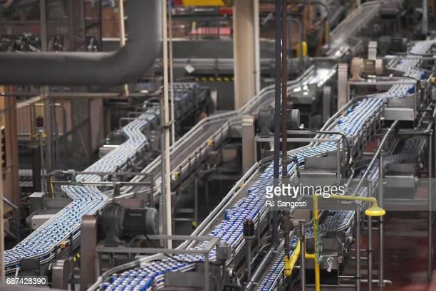 Cans of Bud Light run through the can filler at the AnheuserBusch Brewery on May 23 2017 in Fort Collins Colorado