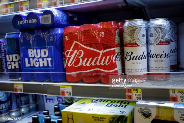 Cans of Budweiser and Bud Light sit on a shelf for sale at a convenience store, July 26, 2018 in New York City. Anheuser-Busch InBev, the brewer...