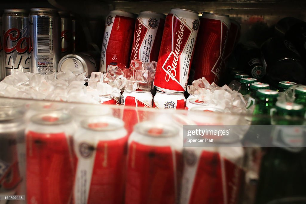 Cans of Budweiser beer are displayed in a deli on February 27, 2013 in New York City. In a new class action lawsuit against Anheuser-Busch, beer enthusiasts have accused the company of watering down its Budweiser, Michelob and other beers. The suits, which were filed in Pennsylvania, California and other states, are seeking millions in damages for allegedly cheating customers out of the alcohol content stated on labels. Anheuser-Busch calls the suit groundless.