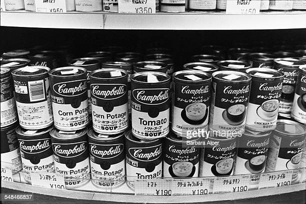 Cans of Campbell's soup with labels in English and Japanese on display in a Tokyo department store February 1988