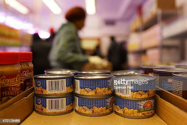 Cans of chicken breat sit on a shelf at CAMBA's Beyond Hunger Emergency Food Pantry on February 18 2014 in the Brooklyn borough of New York City The...