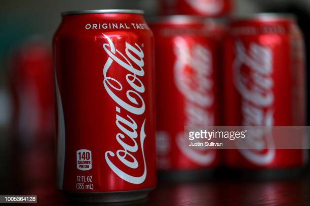 Cans of Coca Cola are displayed on July 25 2018 in San Rafael California Coca Cola announced plans to raise soda prices in North America due to...