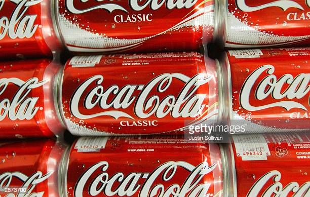 Cans of CocaCola are seen on the shelf at Tower Market January 16 2004 in San Francisco California CocaCola is being investigated by US regulators...