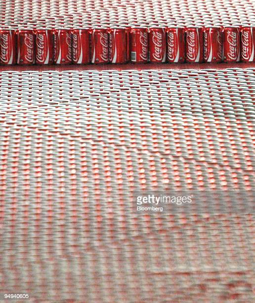 Cans of CocaCola softdrink move along a production line at the CocaCola Amatil Ltd bottling plant in Sydney Australia on Thursday April 30 2009...