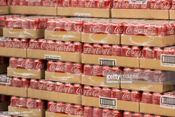 Cans of Coca-Cola stacked up for sale in a supermarket on February 15, 2016 in Cardiff, United Kingdom.