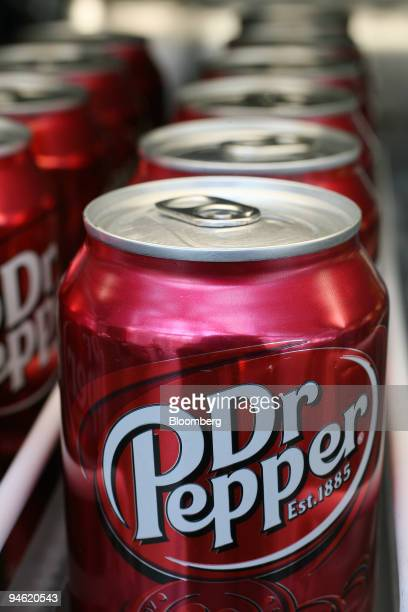 Cans of Dr Pepper sit on a pantry shelf in New York Tuesday June 19 2007 Cadbury Schweppes Plc the world's biggest candy company plans to cut 7500...