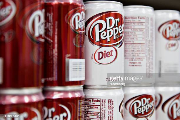 Cans of Dr Pepper Snapple Group Inc Diet Dr Pepper brand soda are displayed for sale at a supermarket in Princeton Illinois US on Monday Jan 29 2018...