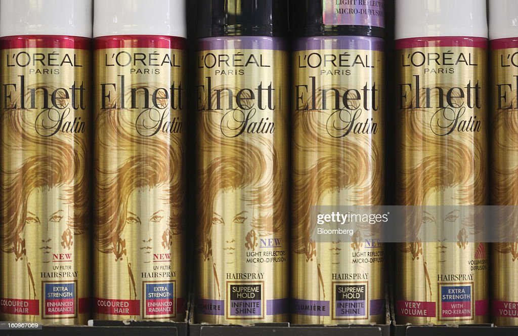 Cans of Elnett hair spray, produced by L'Oreal SA, sit on a shelf inside a supermarket in London, U.K., on Friday, Feb. 8, 2013. Britain's economy will grow more slowly this year than previously forecast and stagnation may persist, according to the National Institute of Economic and Social Research. Photographer: Chris Ratcliffe/Bloomberg via Getty Images