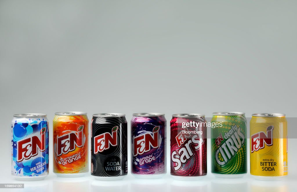 Cans of Fraser & Neave Ltd.'s F&N sparkling drink in various flavors are arranged for a photograph in Singapore, on Monday, Jan. 21, 2013. Thailand's richest man came closer to winning control of Fraser & Neave after a rival group failed to top his S$13.8 billion ($11.2 billion) offer for the 130-year-old property and beverage company. Photographer: Munshi Ahmed/Bloomberg via Getty Images