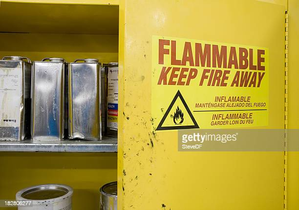cans of hazardous chemicals in storage locker - flammable stock photos and pictures
