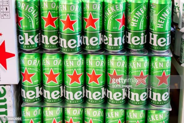 Cans of Heineken beer seen in a supermarket.