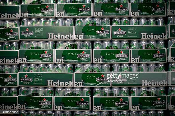Cans of Heineken NV beer sit sealed in boxes at the company's brewery in Den Bosch Netherlands on Tuesday Nov 19 2013 Heineken NV the world's...