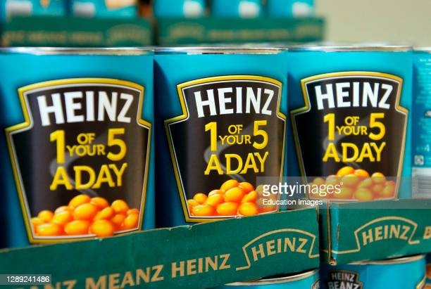 Cans of Heinz baked beans in store.
