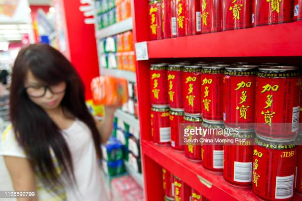 Cans of JDB drink are pictured at Carrefour supermarket in Beijing 13SEP13 == Photo by Simon Song ==