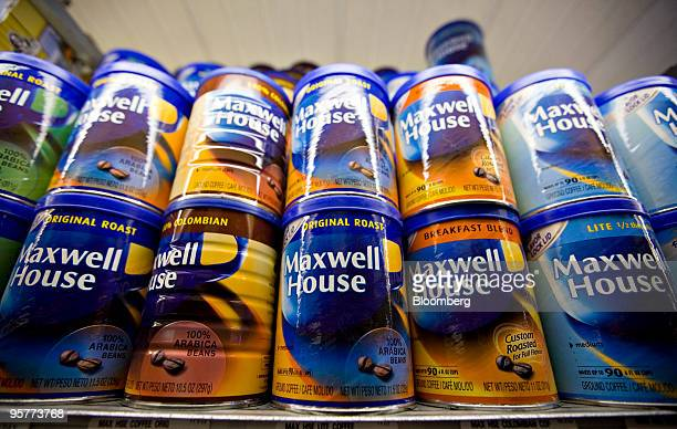 Cans of Kraft Foods Inc Maxwell House coffee sit on display in a supermarket in New York US on Thursday Jan 14 2010 Hershey Co authorized a bid for...