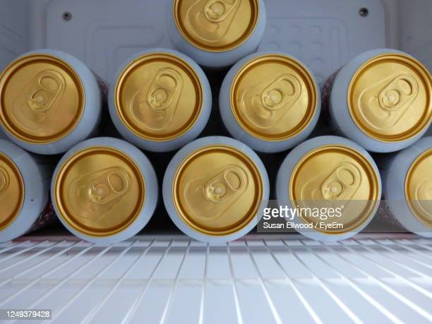 cans of lager stacked up in drinks chiller - tin can stock pictures, royalty-free photos & images