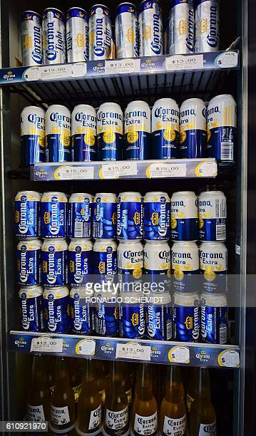Cans of Mexican Corona beer are pictured in a supermarket in Mexico city on September 28 2016 BelgianBrazilian brewer AB InBev savoured its status as...