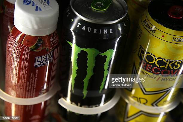 Cans of Monster Energy Drink are displayed on a shelf at a convenience store on August 14 2014 in Kentfield California CocaCola Company announced...
