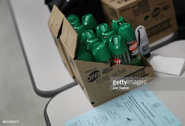 Cans of mosquito repellent are seen as the Florida Department of Health gives free Zika virus tests at a temporary clinic setup at the Miami Beach...